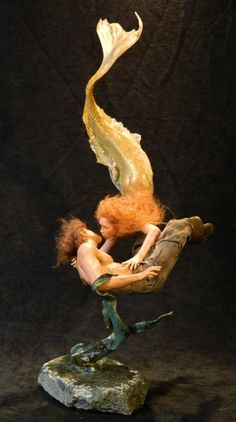 Mermaid and the Drowning Sailor by sculpture artist Mark Dennis. The appearance of weightlessness is amazing.