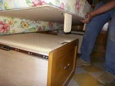 Drawers on casters with full extension slides pull out to support the mattress. GREAT idea for the RV!