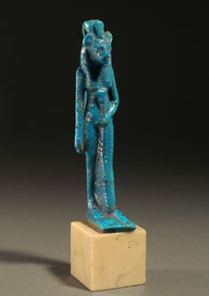 Front; Sekhmet amulet 2 of 2 Circa. 305 to 330 B.C., Ptolemaic Period Measurement; h. 8.80 cm.     Materials;  Faience and glaze constituents.  Information; Sekhmet is adorned sceptre and headdress bearing a uraeus. This amulet was part of the J.M.E. collection, New York. Acquired from Sotheby's, New York, June 1988. Exhibited;  The New York International Antiquarian Fine Art Fair, New York, November 2001 Reference; SNP07JE COPYRIGHT © Royal Athena