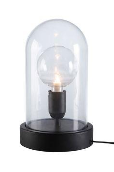 Pöytävalaisin polyresiiniä ja kirkasta lasia. Musta johto, jossa virtakytkin, johdon pituus 1,8 m. Mitat: 33x18x18 cm. E27. Enintään 60 W. Lamppu ei mukana. Eri kokoisilla ja -tyyppisillä lampuilla on suuri vaikutus valaisimen ulkonäköön. Kokeile!