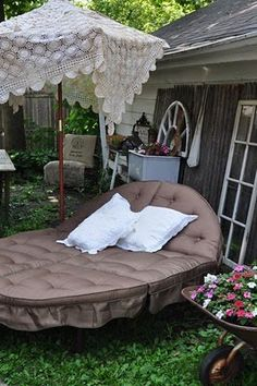 Vintage tablecloth over patio umbrella