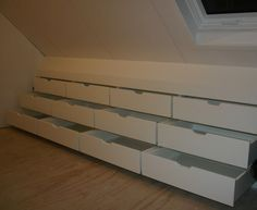 love these wide drawers in attic kneewall