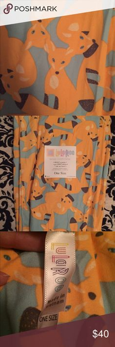 LLR OS Yellow Foxes Leggings - HTF unicorn Really cute little foxes! I like these a lot and would love to keep them if they don't sell, but for now I just need to clear out my closet! Butter soft, never worn or tried on. Green background is like a mint green LuLaRoe Pants Leggings