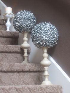 Spray paint faux greenery orbs with Krylon paint