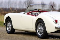 MG MGA 1500 roadster, 1959  ════════════════════════════════ http://www.alittlemarket.com/boutique/gaby_feerie-132444.html ☞ Gαвy-Féerιe ѕυr ALιттleMαrĸeт  https://www.etsy.com/shop/frenchjewelryvintage?ref=l2-shopheader-name ☞ FrenchJewelryVintage on Etsy  http://gabyfeeriefr.tumblr.com/archive ☞ Bijoux / Jewelry sur Tumblr