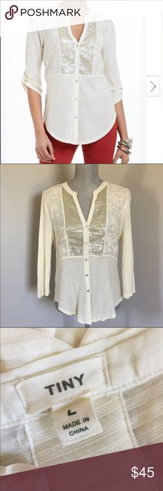 """Anthropologie Sequin Placket Henley Size Large Anthropologie Ivory Sequin and Lace long sleeve shirt.  Sequin plaquet front Henley by Tiny.  Sleeves have button tab for rolling up to elbows.  Sequin patch detail at back. Flatteringly longer in back.  Silk-Cotton-Viscose-Polyester. Size Large.   All measurements are approximate and taken laying flat.  Bust 39"""" (from underarm seams.) Waist 37"""" Hips 41"""" Sleeve length 38.5"""" Total length is 27"""" Fabric is not very stretchy. Anthropologie Tops…"""