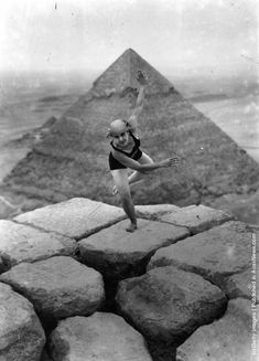 1928: A woman dancing on the Sphinx. A pyramid can be seen in the background