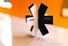 """""""Custom shaped business cards that lock together. Printed on 24pt cardstock with black matte foil"""" Designed by: Jake Brakson"""