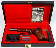 Lot 389: Browning Medalist .22 Cal. LR Semi-Automatic Pistol (Serial #52786T73); Made in Belgium; 10-round magazine fed target pistol in presentation case with extra magazine, weights and operation pamphlet