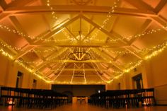 Warm gold uplighting and thousands of sparkling lights in the Ballroom at Stoke Place Stoke Place, Event Lighting, Wedding Lighting, Sparkling Lights, Mood Light, Fairy Lights, Lanterns, Chandelier, Building
