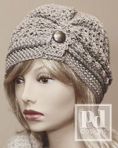 Ruched Lace Beanie with Button Tab. Love this! Too bad she only has the pattern for it and I don't know how to knit