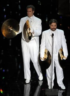 #Oscars 2012: Zach Galifianakis and Will Ferrell present at the Academy Awards in matching white tuxedos.