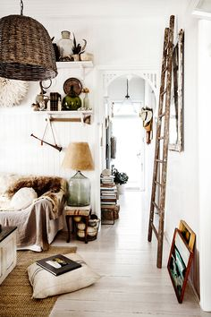 Bright white and dark(ish) wood and natural fibers... Loving that smoky lamp and the basket hanging lamp.
