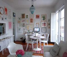 Loving plain white walls covered with pictures.