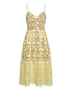 Self Portrait Azaelea Lace Dress: Empire waistline leads into a full skirted bottom. Thin straps. Zipper closure at back. Semi sheer. Partial Mesh lining. In pale yellow. Model Measurements: Height 5'10 1/2; Waist 24 ; Bust 31 wearing size 4 Length from shoulder to hem: ...
