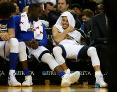 . Golden State Warriors\' Stephen Curry (30) laughs with Golden State Warriors\' Draymond Green (23) during their game against the New Orleans Pelicans in the fourth quarter at Oracle Arena in Oakland, Calif., on Monday, March 14, 2016. (Nhat V. Meyer/Bay Area News Group)