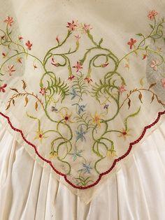 Fichu Date: 1840–60 Culture: American Medium: cotton, silk Dimensions: 44 x 44 in. (111.8 x 111.8 cm) Accession Number: 2009.300.3175 Metropolitan Museum of Art