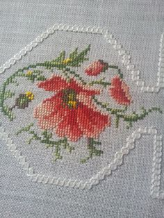 Amazing cross stitch floral embroidered linen tablecloth.  Excellent condition.  Measures:62 cm long  62cm widht