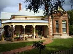 - Brick Italianate Stand-Alone House, Iron Roof & Cream Trim. Modern Victorian, Victorian Homes, Dream House Plans, My Dream Home, Beautiful Buildings, Beautiful Homes, Cottage Design, House Design, Little Cottages
