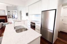 caesarstone bianco drift counters + white cabinets