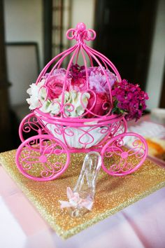 A Nancyfangles Design Idea: A few added crystals and some mini lights would add a Sparkle to this already pretty in pink centerpiece! Pink Carriage Centerpiece pit for a Princess! #princess #party#burtonandburton