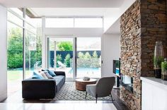 Stone Wall Living Room: A decorative wall full of character and style! Stone Wall Living Room, Living Room Modern, Living Room Interior, Living Room Furniture, Living Rooms, Beautiful Houses Interior, Beautiful Homes, Sofas, Window Design