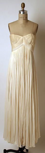 Evening dress Designer: Madame Grès (Alix Barton) (French, Paris 1903–1993 Var region) Date: ca. 1962 Culture: French Medium: silk Dimensions: Length at CB: 48 in. (121.9 cm) Credit Line: Anonymous Gift, 1983