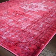 Overdyed rug with a distressed Persian-inspired motif.