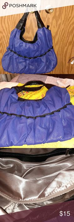 Purse.      **XMAS SALE** Beautiful royal blue and black purse with zipper divider inside zipper pocket and other pockets.  Slightly used..Nice satin beige lining inside and clean smoke free environment! Bags Shoulder Bags