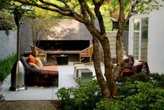With a roaring fireplace, a heat lamp, and cozy, colorful cushions, this outdoor living room byLos Angeles landscape design firm and nurseryInner Gardens would be my favorite place to hang year-round.