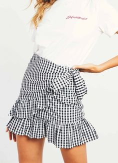 Be picnic ready in the cutest gingham skirt to date!  - Fitted mini skirt  - Gingham fabric  - Ruffle hem  - Wrap around front  - Partially lined  - Invisible zipper  - Cotton, Polyester