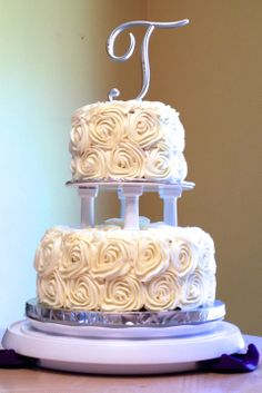 2 tier rosette wedding cake for my friend's vow renewal. I made a red velvet cake with cream cheese frosting, and man, was it yumm-o!!!