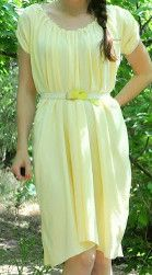 Grecian Sundress. You won't want to take off this beautiful Grecian Sundress this summer. Gathered at the neck, this flowy sundress sewing pattern is super easy to make. Made with a light knit this lovely DIY dress is comfortable and doesn't even need to be hemmed. #sewing