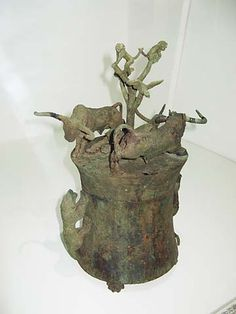 Bronze Cowrie Container. A leaping tiger (between the two oxen, only its forepaws are visible in this photo) menaces two oxen on the lid, while two more tigers climb up the sides of the container. A flying bird and two monkeys in a tree observe the scene. Western Han Dynasty (206 BC - 25 AD) Yunnan Provincial Museum, Kunming