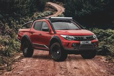 Today's is the Diamondback Concept from It's fitted with black alloys, light bar, bed storage system and its black accents highlight the rich red diamond paint. Mitsubishi Truck, Mitsubishi L200, Mitsubishi Motors, Truck Rims And Tires, L 200, Truck Accesories, All Power Rangers, Outlander Phev, Pajero Sport