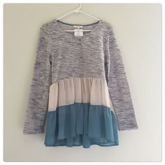 🆕 Ruffle hem sweater top Soft ruffle hem sweater. Size S. Brand new with tags. Sweaters