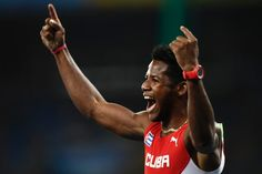Cuba's Leinier Savon Pineda celebrates after winning the 100M T12 during the Paralympic Games in Rio de Janeiro, Brazil on September 15, 2016. / AFP / CHRISTOPHE SIMON