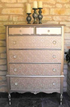 Textured Wall paper covered drawers with metallic paint