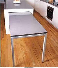Island with pull-out Table for more seating or pasta-making! - Fine Homebuilding Article