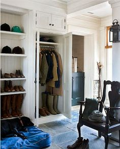 coat closet but higher bar for adult coats and lower bar for kids to reach coats. shoe shelves but with doors too, and hooks for school bags.