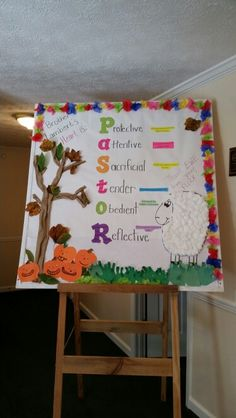 Pastor appreciation bulletin board. The grass is the kids handprints curled with a pencil. Real leaves on a rolled up paper tree trunk.  Pumpkins and cotton ball sheep also done by the kids.