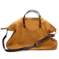 Canvas and Leather Weekender Bag. Also comes in Black. Holds 5 outfits and laptop. Perfect.