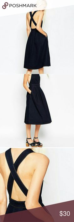 🆕Asos demin midi dress This is a Asos denim cross back midi dress it is 100% cotton  dark denim it is definitely a great spring look for the great weather ahead don't miss out bundle two items and recieve a discount comes with boutique sales tags only ASOS Dresses