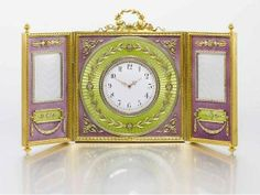 A rare three-part hinged clock and picture frame of gilded silver, decorated with mauve and apple green translucent enamel and pearls, by Johann Viktor Aarne (St. Petersburg, 1899-1908).