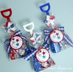 """Gift bags for 4th of July made with shovels.  Tag says """"I dig the USA""""  and bag contains bubbles, candy necklaces, etc"""