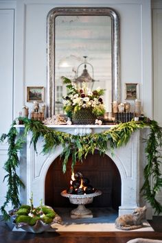Gorgeous fireplace mantel and notice the garden plant urn as the fire pit inside the fireplace