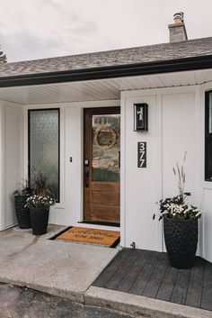 We are FINALLY sharing our modern exterior home renovation… around the entryway at least! Here's the before and after of our front entry exterior as well as all the sources and DIYs in the space. #HomeRenovation #CurbAppeal #ModernRanch
