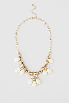 """The lovely SoCo Teardrop Necklace boasts faceted teardrops and sparkling rhinestones strung from golden beads, creating a tasteful statement necklace that can be paired with any blouse or dress. Finished with a lobster clasp claw. <br><br>  -18"""" length<br>  -3"""" extension<br>  -Lead & nickel free<br>  -Imported<br>"""