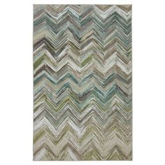 Add a fun pop of pattern and color to your living space with the Mohawk Riverdance Chevron Area Rug - Blue. This nylon rug has a lovely multi-colored abstract chevron pattern in pretty earth tones of blue, green, ivory, brown and gray. shades of orange, yellow, pink, blue and gray. This creates an eye-catching color scheme that'll complement a variety of decor styles. Designed for durability, this low pile rug has a nylon backing and a machine-tufted construction. This chevron rug is ...