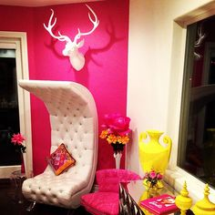 Beautiful! White tufted chair + pink + pink damask chair + mirrored furniture+ pops of yellow.